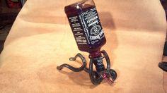 Bottle holding Horseshoe Cowboy by MaceMetalandLeather on Etsy, $25.00
