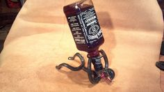 Bottle holding Horseshoe Cowboy by MaceMetalandLeather on Etsy, $25.00