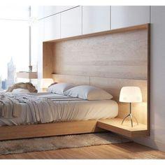 O nicho embutido deu a ideia de cabeceira de cama e ficou original.