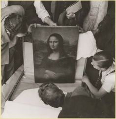 Opening the Mona Lisa at the end of WWII, 1945- Leonardo da Vinci's smiling maiden moved at least six times during the war before she was brought, safe and sound, back to the Louvre.