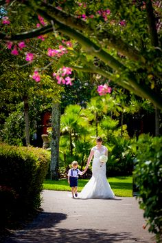The cutest bridal escort for a ceremony at Disney's Polynesian Village Resort at Luau Beach