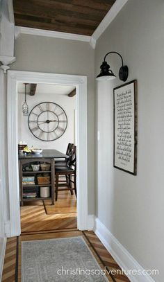 This hallway/house transformation is incredible! Love the mix of farmhouse and victorian styles. The wood ceiling is everything!
