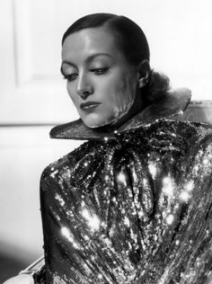 Joan Crawford - Photo by George Hurrell from Sadie McKee (1934) in a cape by Adrian