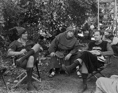 Errol Flynn, Eugene Pallette, and Ian Hunter relaxing on the set of The Adventures of Robin Hood (1938)