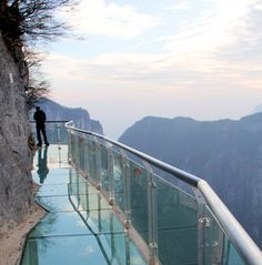 Amazing transparent pathway is located 4,700 ft (1,430 m) above sea level on the side of Tianmen mountain in Zhangjiajie, China.      Constructed out of 2.5 inch crystal-clear glass, this walkway allows people to enjoy breathtaking views of the mountains.