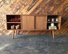Mid Century Style Custom Walnut Compact Credenza  newly handmade, walnut wood, mid century style. front doors with adjustable interior shelving, side storage with adjustable shelves  can be made in different sizes, please inquire for pricing  L:60 D:16 H:28  $350 is partial payment for full shipping fee to be calculated after sale