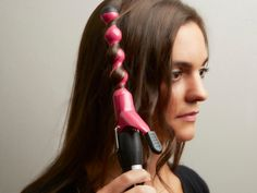 Consider this the ultimate curling iron…with a lot of lumps and bumps. The little bubbles help create the perfect imperfect curl. All you do is take a strand of hair and wrap it around the wand. The bubbles make the curls less precise and more loose and haphazard.