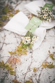 Dainty wildflowers and rosemary escort cards