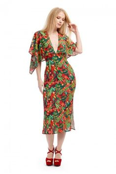 e2973ceeddd9a Tina Tropical Paradise Kimono Dress at Collectif. Get ready for summer with  our Tropical Kimono Dress featuring vibrant print of leaves.