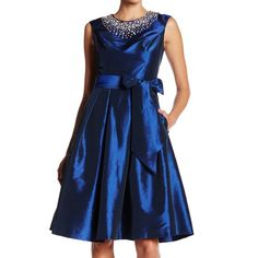 """Shop Women's Eliza J Blue size 8 Midi at a discounted price at Poshmark. Description: Eliza J Bejeweled Mid Length Party Dress in blue with sash size 8 NWT $178 Sash around the waist zipper in back lined 50% polyester, 50% nylon Bust: 19"""" across Waist: about 15"""" across Length: 42.5"""" retails for $178 About This Item Details - Scoop neck - Sleeveless - Back hidden zip closure with hook-and-eye clasp - 2 on-seam pockets - Fit and flare silhouette - Paneled construction - Fron..."""