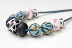 Beautiful minimal polymer clay necklace. Perfect for everyday wear or special occasions. The round beads of this necklace were rolled and shaped freehand, then baked strung onto a leather cord with sterling silver lobster clasp. Each necklace is unique, with every bead and piece handcrafted with love and care. Visit the store: etsy.com/shop/SunlightGarden Polymer Clay Necklace, Leather Cord, Round Beads, Special Occasion, Shapes, Sterling Silver, Lobster Clasp, Unique, Minimal