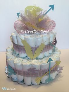 Baby Shower Diaper Cake (American Indian Theme)  http://www.facebook.com/Coe-Creations-Beautiful-Homecoming-Mums-at-Affordable-Prices-231054123599172