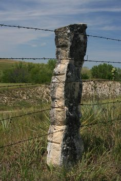 A stone fence post north of Russell in Russell County, Kansas.