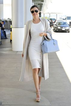 Who: Miranda Kerr What: Easy White Dress Why: The model keep it cool and casual in a simple figure-flattering white dress. Get the look now: Neil Barrett dress, $495, stylebop.com   - HarpersBAZAAR.com