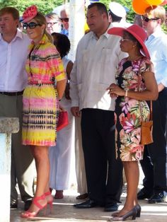 Máxima wears a colorful dress. Click on the image to see more looks.