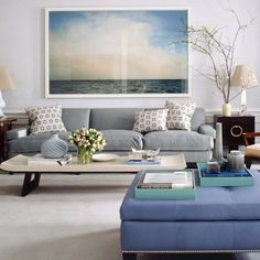 what a calm living room/sitting room. the ocean photography is well done in that big glossy frame with no matting.