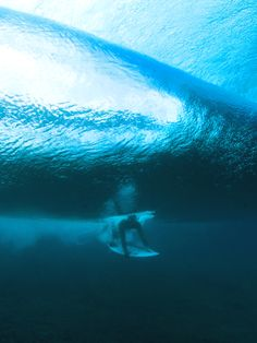 Surf South Africa | surfing blog  Duck-diving under a clear blue set wave in Hawaii.