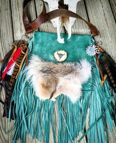 A personal favorite from my Etsy shop https://www.etsy.com/listing/261687125/ooak-turquoise-leather-bag-country