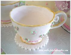 Gum paste teacup Tutorial, requires at least 1 week to make for drying.  Forms gum paste in mold, flutes edges, creates base, creates handle.  Maybe for mothers day.  See her gum paste teapot.  WOW.