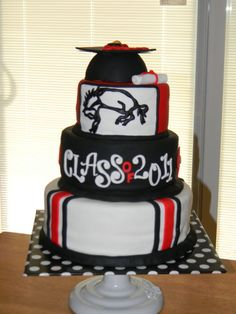 High School Graduation Cake - This was a fun cake to make because it was for a boy graduating from my alma mater! the bottom tier is vanilla, the middle tier is chocolate, and the top tier is vanilla & chocolate. The cap was made with chocolate cake, using half of a ball pan and then trimming the excess, topped with fondant. Hope you like it!