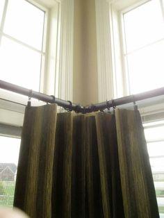 Window treatment ideas for sliding glass doors in a kitchen. Corner bracket for decorative drapery rod. Window Treatments Toledo Ohio - Bellagio Window Fashions