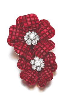 RUBY AND DIAMOND BROOCH, 'DEUX FLEURS', VAN CLEEF & ARPELS, 1996 Designed as two flowers, the petals composed of rubies en serti mystérieux, the pistils set with brilliant-cut diamonds, signed Van Cleef & Arpels, numbered, French assay and maker's marks, case stamped Van Cleef & Arpels.