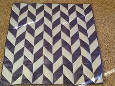 Navy and grey herringbone baby boy quilt hand quilted and bound flannel backed