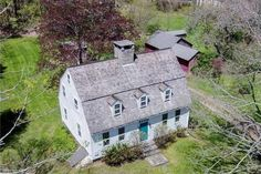 Antique Center Chimney Gambrel a blend of old charm w/newer updates make this a warm-inviting home! Country kitchen, bright sunroom, formal DR and LR. Exposed beams, wide-plank flrs, built-ins. Open pastoral setting w/antique outbldgs/gardens/stonewalls.
