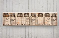 Our mason jar art is farmhouse art that will look great on any wall space! Lined with beautiful mason jars this wall art is way too perfect! For more visit, www.decorsteals.com OR www.facebook.com/decorsteals