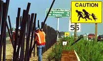 Caution Caltrans sign by graphic artist John Hoods near inland San Onofre border checkpoint.