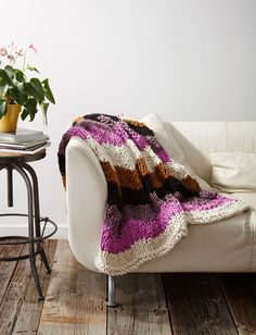 Get both a chic DIY home decor item and a cozy throw with this free knitting pattern. The Rolling Waves Knit Throw will have you happy (and excited!) to sit down, relax, and snuggle on your couch because this knitted throw is oh-so-soft. Knitted Throw Patterns, Knitted Afghans, Easy Knitting Patterns, Afghan Patterns, Knitted Blankets, Free Knitting, Knitting Bags, Crochet Patterns, Knitting Supplies
