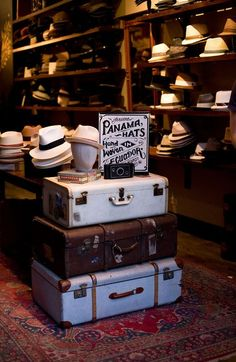use vintage luggage as an end table, then also use the luggage as storage, maybe even place natural wood tray as a topper to hold a lamp