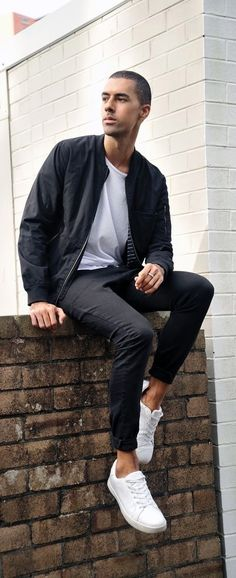 Fall monochrome idea with a black bomber jacket white t-shirt black denim no show socks white sneakers.