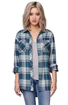 """The women'sGraphic Back Plaid Shirt by Gypsy Warrior for PacSun and PacSun.com offers a super soft flannel construction and unexpected graphic on the back. The shirt has a classic button up style and relaxed fit. Wear it with our skinniest jeans for an easy casual look!   29"""" length 23"""" sleeve length Measured from a size small Model is 5'9"""" and wearing a small 60% cotton, 40% polyester Machine washable Imported"""