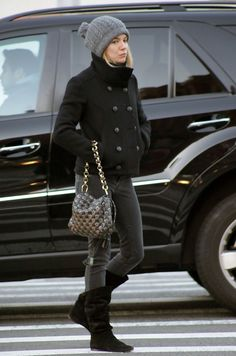 Sienna kept comfy in the cool weather and sported skinny jeans with a pair of black suede, scrunched, flat boots.