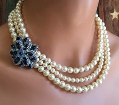 A personal favorite from my Etsy shop https://www.etsy.com/listing/294920519/pearl-necklace-with-navy-blue-rhinestone
