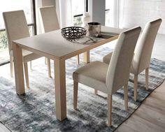 Mesa porcelánico / Sillas tapizadas: Comedor de estilo de INTERIORS TON SARRÀ
