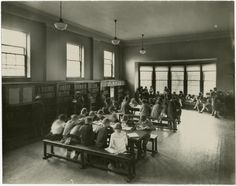 Riverdale Library, Toronto Public Library, interior vintage photo circa 1927 of the new Boys and Girls / Children's addition - see bay window and separate Boys / Girls entrance on exterior photo.  See also the other interior photo showing the roaring fire in the fireplace.