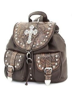Dark Brown Faux Leather Western Rhinestone Cross Backpack.  $49.99            Look great wearing this fabulous western rhinestone cross backpack with great features such as Front Magnetic Snap Pocket, Included Adjustable Shoulder Strap, Metal Feet on the Bottom, Open & Zippered Pockets Inside, Rear Zipper Pocket, Zipper Closure, Top Flap Link Closur...