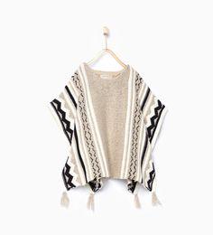 Jacquard knit poncho from Zara