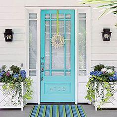 Fun Turquoise Front Door-love the starfish wreath!