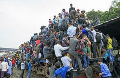 These staggering images capture the crushing daily grind for commuters in Bangladesh, which sees thousands of workers clambering over one another to board a train out of Dhaka city