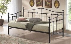 3ft Day-bed Deluxe Black Frame - £179.95 - Superb quality day bed frame in black. Ideal for bedrooms, offices etc and can be used as a sofa and a bed.  A very very popular frame which has some lovely detailing with scalloped designs in the metalwork.  The frame itself is made from steel with the base part being made up from a slat system which uses sprung slats for comfort.