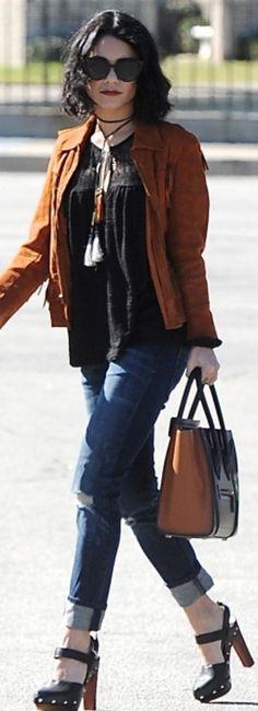 Who made  Vanessa Hudgens' blue ripped jeans, black handbag, and brown studded platform shoes?