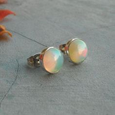 Buy Real opal stud earrings silver by aStudio1980 Online at aStudio1980.com. Enjoy FREE shipping now. 100% handcrafted and original.