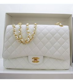 "White ""Chanel"" Classic Flap Bag. In the 1920s, Coco Chanel became tired of having to carry her handbags in her arms and decided to design a handbag that freed up her hands. Inspired by the straps found on soldiers' bags she added thin straps and introduced the resulting design to the market in 1929. ;)"