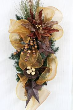 Primitive Christmas Door Swag, Gold Poly Mesh, Primitive Stars, Poinsettia, Bird Nest, A Front Door Swag for Christmas. $92.00, via Etsy.