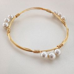 Pearl trio gold wire wrapped bangle / gold pearl by LuminaJewelsCo