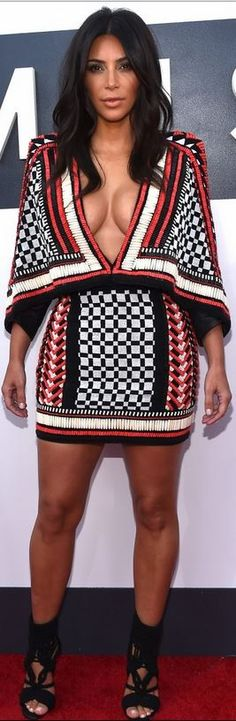 Who made Kim Kardashian's black woven sandals, jewelry, and red beaded dress…