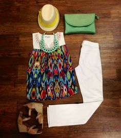 Spring weather is finally here this weekend and at Vanessa V. Boutique we have you covered! This colorful top is perfect for any spring plans available in XS-L. Wear it with white denim by Cj by Cookie Johnson this is the Faith Straight fit that goes great with these wedges available in 0-18. Come in today we are open until 6 or call us at 337.504.4467.
